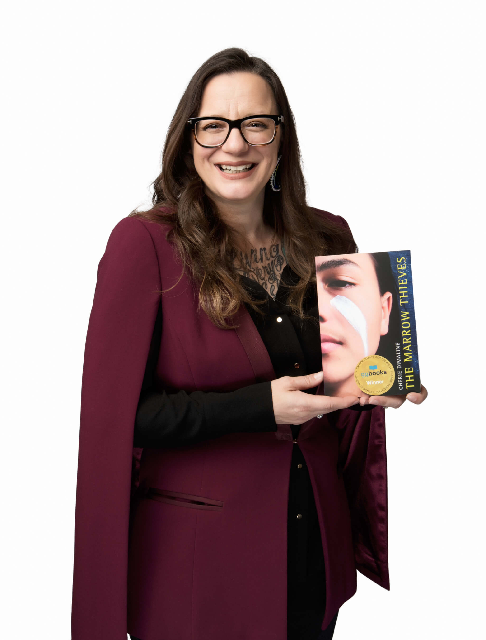 Cherie Dimaline holding The Marrow Thieves book