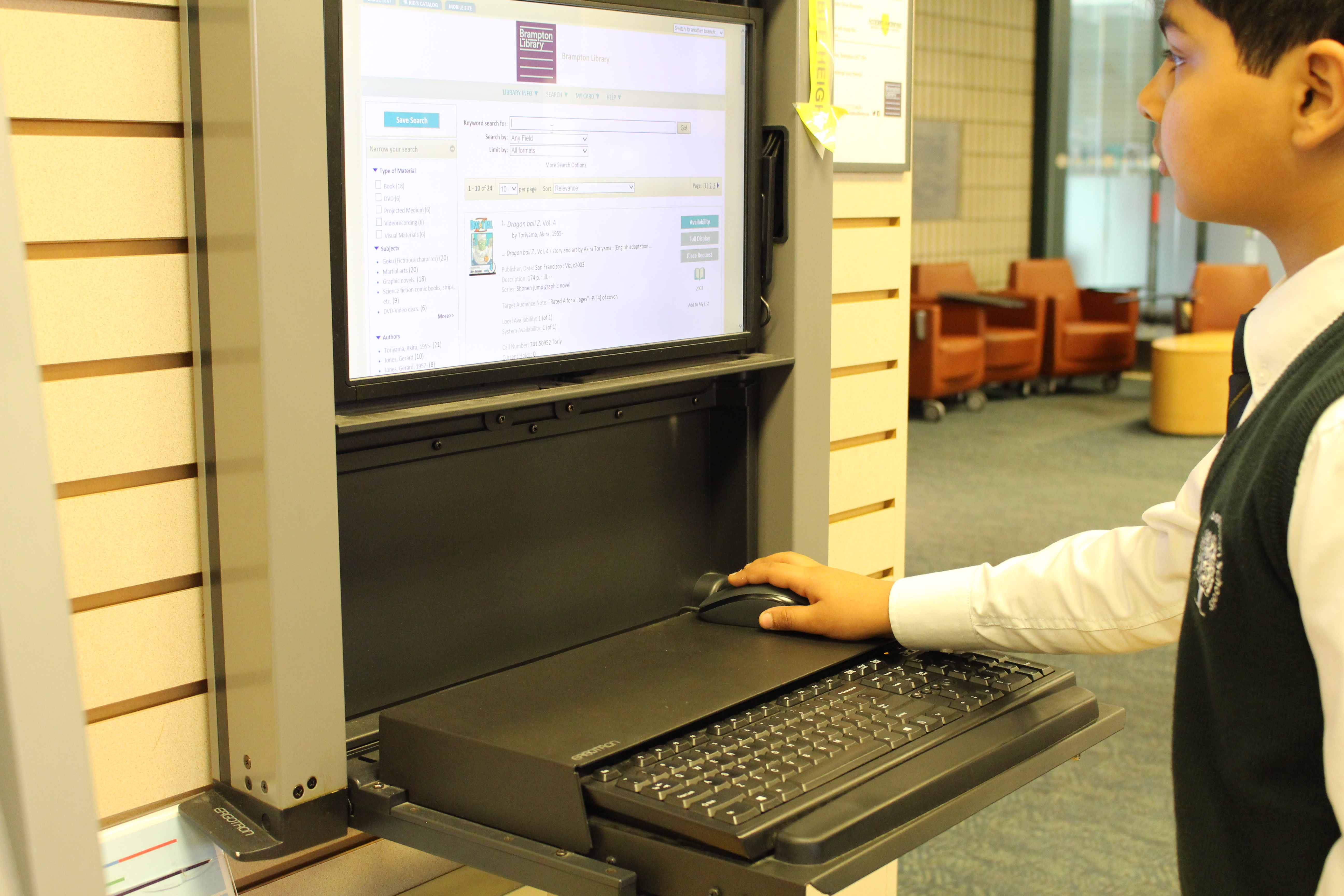 An RMS student searching through the Brampton Library catalogue